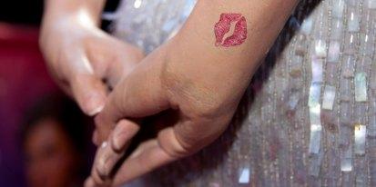 Britney Spears kiss tattoo