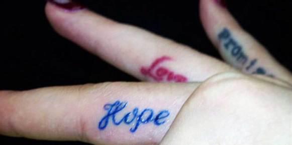 Rita Ora finger tattoo hope love promise